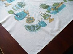 Vintage Tablecloth Teal Blue with Green and Gold Kitchen Utensils 63 x 53 1950s