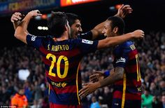 Suarez celebrates with Sergio Roberto and Neymar after scoring Barcelona's fifth goal against Rayo Vallecano