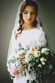 Very vintage bride. White manta veil cathedral length, modest white vintage wedding dress and cascading bouquet // Alex & Julia // Seattle WEDDING · Jessi Livak Photography www.jessilivak.com