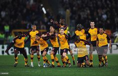 Arsenal players celebrate victory after winning on penalties during the UEFA Champions League, Round of Last 16, Second Leg match between AS Roma and Arsenal at the Stadio Olimpico on March 11, 2009 in Rome, Italy.