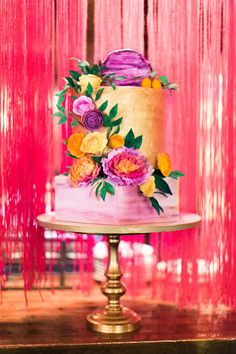 gold and purple wedding cake - photo by Haley Sheffield Photography event and floral design by Juli Vaughn Designs http://ruffledblog.com/bright-modern-NYC-wedding