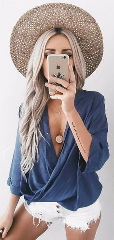 what to wear with fedora / wrapped blouse + denim