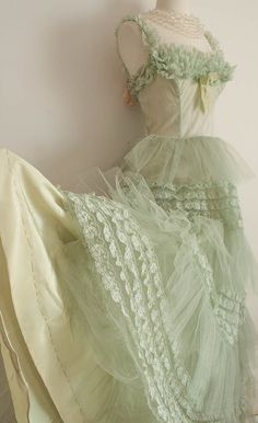 Exquisite frilliness...  This vintage mint-green 1950s prom dress is all ruffles and lace and tulle.  So dreamy!