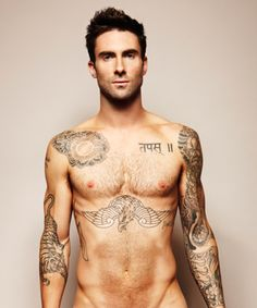 Maroon 5's frontman Adam Levine is practically decorated with tattoos - suits us!