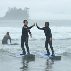 High fives at Cox Bay this morning // #yourtofino #fogust #tofino #surflessons //  @paulmakespictures