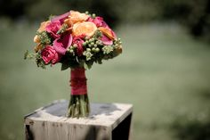 Matt Shumate Photography at High Country Orchard wedding orange and pink roses and flower bouquet