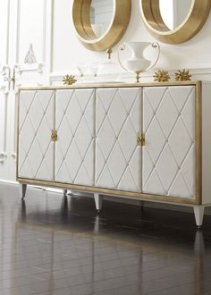 Entertainment unit ?TOP PICK By Beth Dotolo + Carolina V Gentry - http://pulpdesignstudios.com - BERNHARDT - Jet Set Buffett/ 356-132C - White Pearl finish on maple veneers. Gold Leaf finish on the front frame. Four doors wrapped in padded diamond-tufted white bonded leather with tiny nails. Solid brass key-pull hardware. Interior configured for service including wrap padding and silverware insert. Showroom: IHFC Building, Design Center, 6th floor #hpmkt