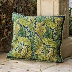 Beth Russell needlepoint kit adapted William Morris' Acanthus Leaves (green on blue) for this cushion pattern.