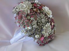 Pink brooch boquet, I love this idea too, means I could get the brooches my nans gave to me or left into my wedding Brooch Bouquet Tutorial, Wedding Brooch Bouquets, Broschen Bouquets, Bouquet Flowers, Do It Yourself Wedding, Just For You, Floral, Wedding Ideas, Wedding Stuff