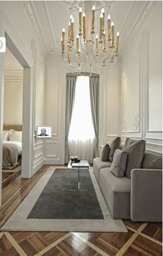 Grey couch, grey carpet, grey drapes - perfect! Sitting area in bedrm...moulding!!!