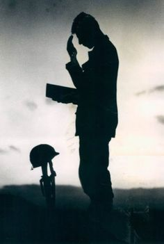 An unidentified U.S. soldier takes a moment to pray for the fallen men on this Memorial Day in Vietnam, May 30, 1968