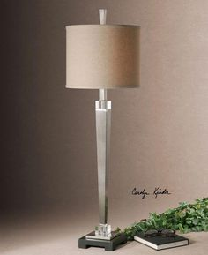The metal base of the Terme Tapered Lamp is finished in a plated, brushed nickel with crystal accents and a black foot. The round hardback drum shade is covered in a beige, linen fabric with natural slubbing. Designed by Carolyn Kinder International. Rustic Mirrors, Rustic Wall Decor, Uttermost Lighting, Nickel Silver, Brushed Nickel, Buffet Table Lamps, Lamp Table, Console Table, Barn Wood Picture Frames