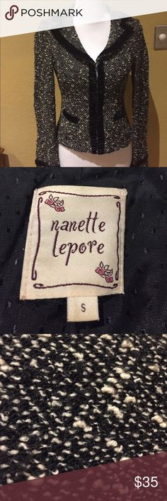 Nanette lepore jacket size small Very cute Nanette Lepore jacket that can be dressed up or down with jeans. Size small acrylic/wool blend it has a nubby texture with a black velvet trim and two small pockets in the front. Front closures with clasps. Nanette Lepore Jackets & Coats Blazers