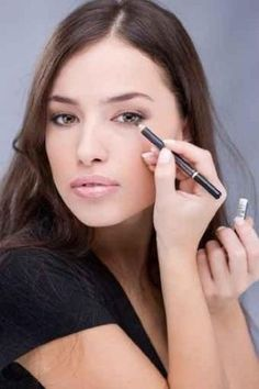 Applying Cosmetic Pencil on Woman's Eye - Peel and Stick Wall Decal by Wallmonkeys    Price: $52.99
