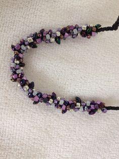 7 warp purple bracelet..Used magatama's, square seed beads, silver seed beads, pearl seed beads and mixed purple seed beads...by Mary