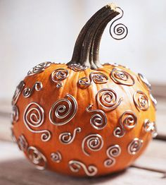 Silver Swirl Pumpkin - I wanted to do this for our wedding. I'll have to save it for a Halloween party :)