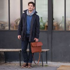 Pair a navy trench with dark blue jeans if you're going for a neat, stylish look. A pair of oxblood leather boots will seamlessly integrate within a variety of outfits.  Shop this look for $351:  http://lookastic.com/men/looks/scarf-crew-neck-sweater-trenchcoat-jeans-messenger-bag-boots/4963  — Grey Scarf  — Blue Crew-neck Sweater  — Navy Trenchcoat  — Navy Jeans  — Brown Leather Messenger Bag  — Burgundy Leather Boots