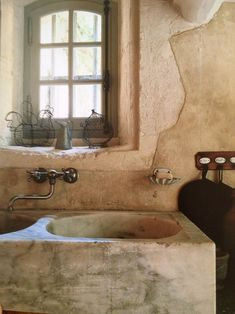 Finally, some Chicken Kitchen inspiration: a rustic stone sink, and a quirky little window looking out towards the chicken garden.