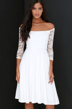 You'll be the epicenter of attention when you hit the town in the Central Square Ivory Lace Midi Dress! Sleek and stretchy knit falls elegantly into a wide bateau neckline finished with sheer, stretch lace off-the-shoulder half sleeves (with no-slip strips). A fitted bodice with princess seams continues to the fitted waist, then flares out into a chic, midi-length skirt. Hidden back zipper. Dress is lined; Sleeves are not. Self: 92% Polyester, 8% Spandex. Contrast: 90% Nylon, 10% Spandex…