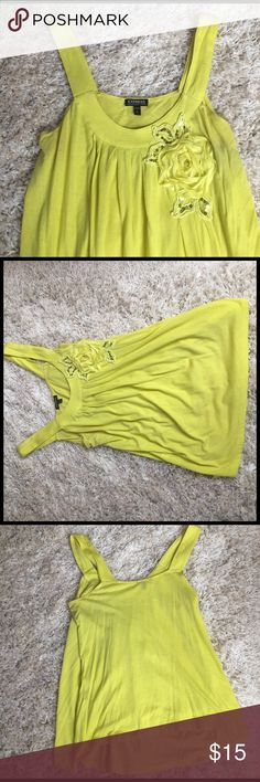 Floral Express Tank Flowy Express tank top that is a gorgeous yellowish-lime color. It fits loosely and has the cutest floral embellishment. Approximately 24inches from top of shoulder to hem. Express Tops Tank Tops