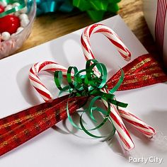 We wish you a YUMMY Christmas! Add a sweet twist to gifts with a couple candy canes and some ribbon - too cute!