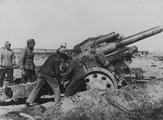 Gunners Wehrmacht Afrika Korps firing of 150-mm heavy field howitzer sFH 18