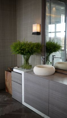 interior design by HBA/Hirsch Bedner Associates. greyed bathroom.