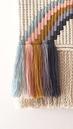Handmade macrame wall hanging made from 4mm natural cotton triple twist cord with woven wool detail on a tasmanian oak rod. Perfect for baby or kids room Measurements ~ Macrame hanging: 28cm width x 57cm length Rod: 36.5cm long Each piece is made to order so please allow up to 2 weeks for