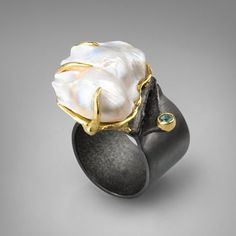 Pearl and sapphire--German Kabirski absolutely fab. I love it.... Birthday coming up...anybody?