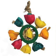 Woven Wonders Blossom Ring Parrot Toy  Lots of natural materials arranged in a fun to chew ring.  Colourful natural materials have been arranged by hand to create this Woven Wonders Blossom Ring Parrot Toy. They're all knotted around a piece of bamboo wood which your Parrot can chew on to keep their beak healthy and trim.  Their bright colours are sure to capture your inquisitive Parrot's imagination.  The ends of the knotted sisal rope are exposed so your bird can use them for preening