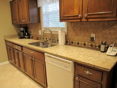 I remodeled the kitchen using the backsplash from Surplus Warehouse. The tile bordering the granite is also from Surplus Warehouse. I have had many complements on the backsplash. -Susan H., Memphis, TN.