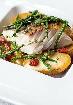 Pan-roast cod with confit Jersey Royals, pancetta, samphire and lemon - Graham Campbell. Seaside flavours of cod and samphire are mingled with terrestrial potatoes and pancetta for a superb main course that would be a real showstopper, whether for a dinner party or an intimate meal, this baked fish recipe will impress.