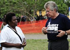 A volunteer speaks with a woman.