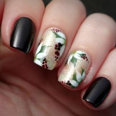 """""""Here is the mani I did for a guest post for @naiildazzlee. Winter/Christmas nails, polishes used are @opi_products Black Cherry Chutney and @chinaglazeofficial White Cap. The poinsettias were handpainted with acrylic paint and a liner brush. If you aren't already following @naiildazzlee make sure you do, sweetest girl ever!!"""" #nail #nailart"""