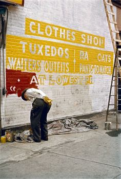 Saul Leiter. 'Sign Painter' 1954  Love sign painters.. the black sheep in the art world family