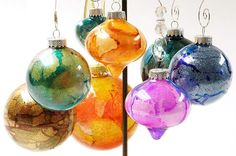 DIY Christmas Ornaments by blog.michaels: Made with Alcohol Ink + Glitter. Easy! #DIY #Christmas_Ornaments #Easy