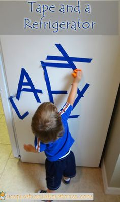 Simple learning through play idea with tape and a refrigerator