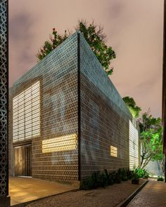 Perforated concrete walls encase La Tallera gallery by Frida Escobedo