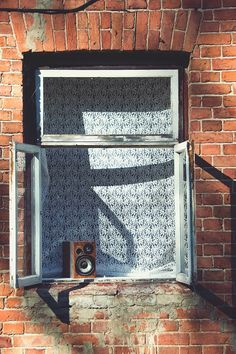 Window on a Brown Brick Wall