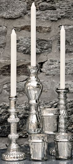 Mercury glass candlesticks and votive holders are on trend and look great in any setting.