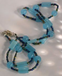 Baby Blue and Multi Colored Dark Seed Bead by TheYellowHouse39