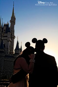 Engagement session at Cinderella Castle in Magic Kingdom Park, complete with Mickey Mouse Ears