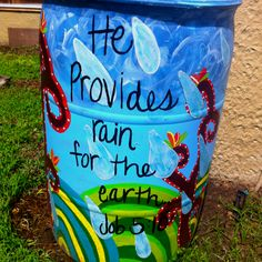 the completed rain barrel. painted by ME! Painted Trash Cans, Rain Barrel System, Water Barrel, Garden Globes, Frog Crafts, Backyard Projects, Urban Farming, Outdoor Art, Yard Art