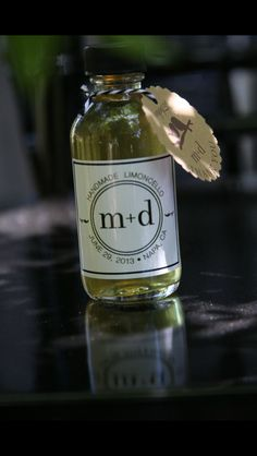 DIY LIMONCELLO wedding favors   Used a recipe I found online and did it 4 months before the big day Husband custom made the labels  Found the bottles at Sunburst Bottle Company online  Penny Sylvia Photography #diyweddingfavor