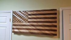 American Flag: Made in the USA Proudly crafted out of Walnut, Mahogany and Maple. Solid wood with inlaid maple stars. Finished size 24 x 45 x 1 Approx. Wall mounting bracket included Perfect corporate gift for lobby or conference room. Mounting Brackets, Corporate Gifts, Valance Curtains, American Flag, Solid Wood, Hardwood, Wall, Usa Flag, Flags