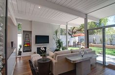 Palo Alto Eichler. Raised roof/ceiling that keeps the original beam structure. Perfection.