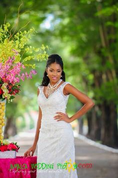 Bride in dress by Bliss Bridal Boutique Jamaica and centerpiece and set design by Helen G Events