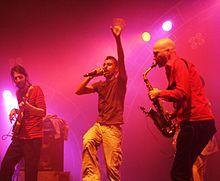 Balkan Beat Box.  Israeli world-beat music.  Middle east mixed with Balkan.  Example: http://spoti.fi/xFEWoX