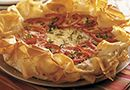 Artichoke & Sun-Dried Tomato Tart - The Pampered Chef®