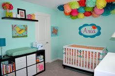 Bright and cheerful nursery with an amazing #pompom display! #nurserydecor